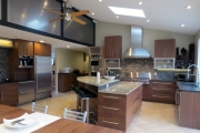 <h5>Aluminum and glass cabinets, black textured antiqued leather granite</h5>