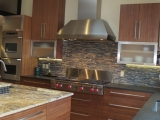 "<h5>Lift up cabinet doors, 48"" Wolf Stainless Rangetop and Hood</h5>"