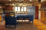 <h5>Blue painted island with brick inlay floor</h5>