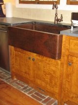 <h5>hammered antique copper farmhouse sink</h5>