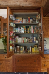 <h5>stone-lined gourmet pantry cabinet</h5>