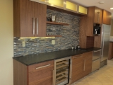 <h5>Subzero freezer drawers, horizontal grain walnut, cabinet lights</h5>