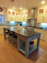 <h5>Bespoke furniture piece island, ivory painted shaker doors</h5>