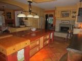 <h5>Custom fireplace mantel surround over fieldstone fireplace</h5>